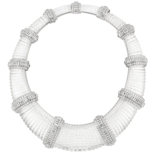Carved Rock Crystal, White Gold and Diamond Necklace Composed of tapered bombe carved rock crystal segments spaced by white gold bands centering 196 baguette diamonds, edged by 207 round diamonds, altogether approximately 35.00 cts. Length 14 inches. C  Estimate $30,000-40,000