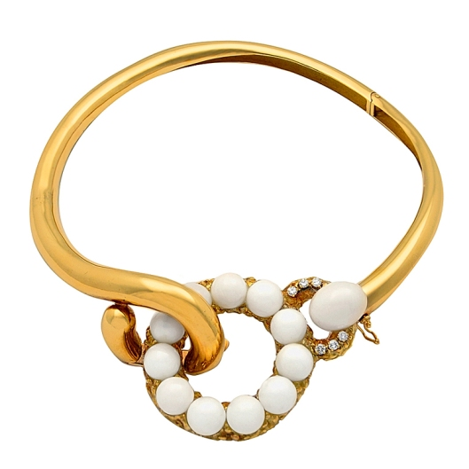18 kt. gold collar with white coral and diamond front clasp. Clasp detaches for use as a pendant. $24,000 via www.1stdibs.com
