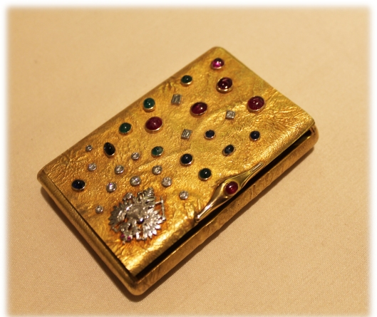 Antique gold case/box with precious stones.