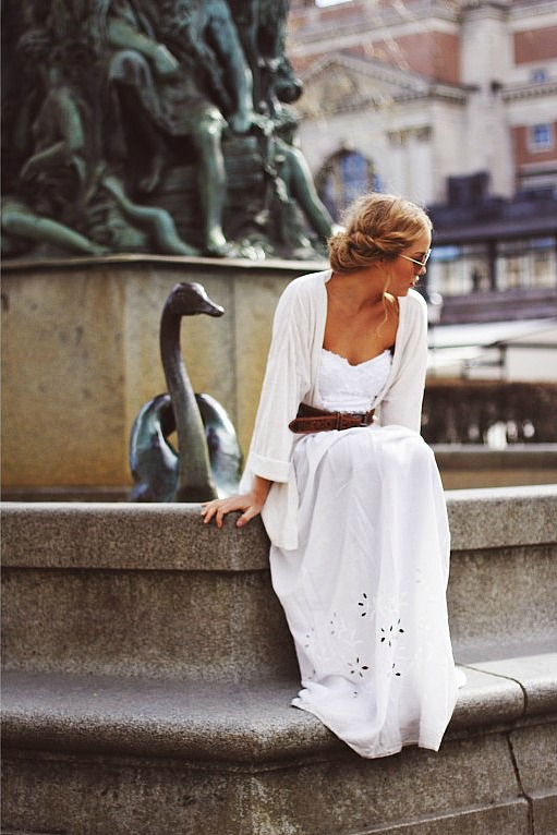 white dress by fountain